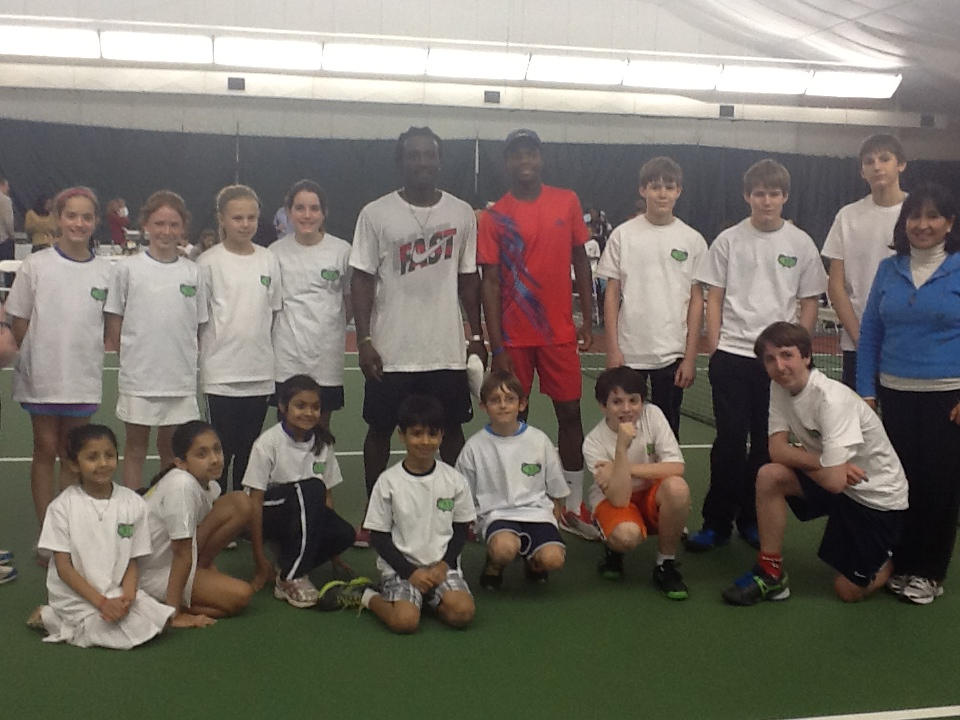 Isaac Donkor and Francis Tiafoe with the ball boys and girls.